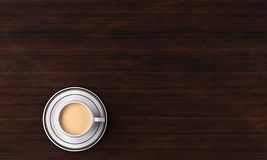 3D Rendering : A cup of milk tea/coffee and the saucer on the table, top view. A cup of milk Tea/coffee with milk with the saucer under it and place on the wood Stock Photos