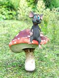 3D rendering of a cartoon mouse sitting on a fairytale mushroom. Stock Image