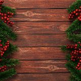 3D rendering dark christmas wooden background. With branches of fir and holly berries Stock Photo