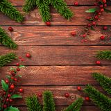 3D rendering dark christmas wooden background. With branches of fir and holly berries Royalty Free Stock Images