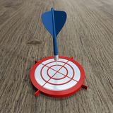 3D rendering dart on target. With wooden background and lens effect vector illustration