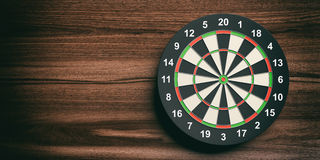 3d rendering darts board on wooden background. 3d rendering colorful darts board on wooden background Stock Photo
