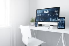 Devices on white minimal workspace finances. 3d rendering of devices on desktop. financial graphics on screen Stock Image
