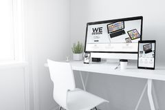 Devices on white minimal workspace responsive design website. 3d rendering of devices on desktop. responsive design mobile apps website on screens Stock Images