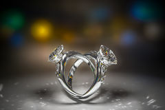 3d rendering of diamond rings with copy space closeup in dark en. Vironment with bokeh background Stock Photography