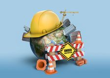 3d rendering of Earth globe, covered with a construction helmet, small buildings and with a fence with a sign Under. Construction. Earthworks and building royalty free stock image