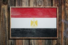 Wooden Egypt flag. 3d rendering of Egypt flag on a wooden frame over a planks wall royalty free stock image