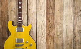 3d rendering electrical guitar near brown wooden wall with ivy Stock Photos