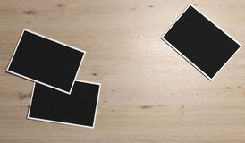 Empty Photos With A Little White Frame. 3D Rendering Of Empty Photos With A Little White Frame On Wood Texture Closeup Stock Image