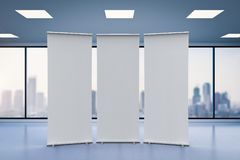 Empty roll up banner. 3d rendering empty roll up banner with office background Royalty Free Stock Photography