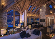 3D rendering of evening living room of chalet Royalty Free Stock Photo