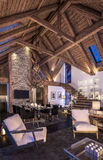 3D rendering of evening living room of chalet Stock Photography