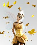 A fairy flying on the sky. 3d rendering of a fairy flying on the sky surrounded by flock butterflies royalty free illustration