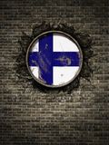 Old Finland flag in brick wall. 3d rendering of a Finland flag over a rusty metallic plate embedded on an old brick wall Royalty Free Stock Images