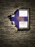 Old Finland flag in brick wall. 3d rendering of a Finland flag over a rusty metallic plate embedded on an old brick wall Stock Photos