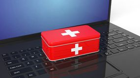3D rendering of first aid kit on laptop's. Keyboard Royalty Free Stock Images