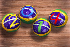 World Cup 2014. 3D rendering of footballs in the year 2014 in a football stadium Stock Images