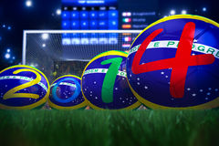 World Cup 2014. 3D rendering of footballs in the year 2014 in a football stadium Royalty Free Stock Image