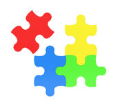 3d rendering of four multicolored puzzle pieces isolated on white background. Stock Photo