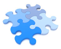 3D rendering of four puzzle pieces in different shades of blue a Royalty Free Stock Image