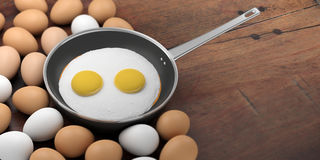 3d rendering fried eggs in a pan Stock Image