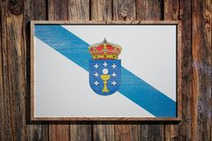 Wooden Galicia flag. 3d rendering of a Galicia flag on a wooden frame and a wood wall Stock Photo