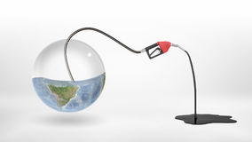3d rendering of gas nozzle attached to a half empty glass earth globe and leaking oil to a puddle. Stock Images