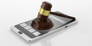 3d rendering gavel auction. On a smart phone Royalty Free Stock Photos