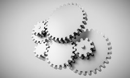 Gears locked in interdependence - concept rendering Stock Photos