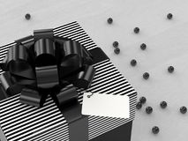 3d rendering of  gift box with black ribbon. On wooden desk Stock Photo