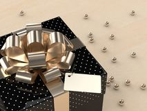 3d rendering of  gift box with golden ribbon. On wooden desk Stock Photography