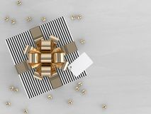 3d rendering of  gift box with golden ribbon. On wooden desk Stock Photos