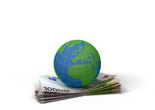 Globe on 100 euro bills. A 3d rendering of a globe on a stack of 100 euro bills Royalty Free Stock Image