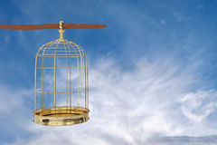 3D rendering of  a golden bird cage on sky,. Freedom concept Stock Images