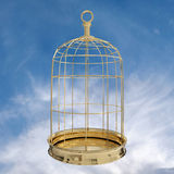 3D rendering of  a golden bird cage on sky. Freedom concept Stock Image