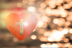 3D rendering of heart with golden cross on abstract background. 3D rendering of heart with golden cross on abstract background, christian concept Stock Photo