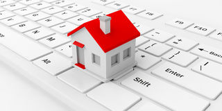 3d rendering house on a keyboard. 3d rendering house on a white keyboard Royalty Free Stock Image