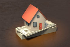 3D rendering of a house on a stack of bank notes. On wooden table Stock Photo