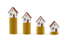 3D rendering of Houses on golden coin stacks Royalty Free Stock Images