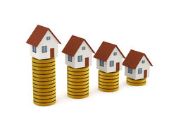 3D rendering of Houses on golden coin stacks Stock Photography