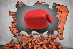 3d rendering of a huge red boxing glove punches right throw a red brick wall with rubble lying around. Royalty Free Stock Photography