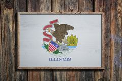 Wooden Illinois flag. 3d rendering of an Illinois State USA flag on a wooden frame and a wood wall Royalty Free Stock Image
