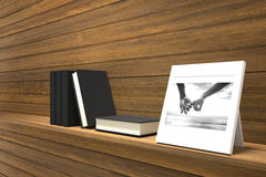 3D rendering : illustration of picture frame of two hand holding together decorate on a wooden shelf with books . Stock Photo
