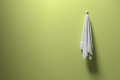 3D rendering : illustration of a piece of clean and white towel hanging on a green pastel wall,light and shadow,copy space Stock Image