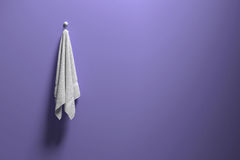 3D rendering : illustration of a piece of clean and white towel hanging on a purple pastel wall,light and shadow,copy space Stock Photography