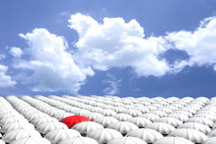 3D Rendering : illustration of Red umbrella among the crowd of many white umbrellas against blue sky and clouds.Business leader. Concept, being different Stock Photos