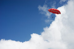 3D Rendering : illustration of Red umbrella floating above against blue sky and clouds. Business, leader concept, being different. Concepts;1st position Royalty Free Stock Image