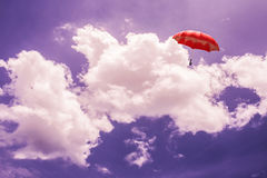 3D Rendering : illustration of Red umbrella floating above against blue sky and clouds. Business, leader concept, being different. Concepts;1st position Royalty Free Stock Photo