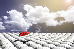 3D Rendering : illustration of Red umbrella floating above from the crowd of many white umbrellas against blue sky and clouds. Business leader concept, being Stock Image