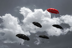 3D Rendering : illustration of Red umbrella floating above on many black umbrellas against blue sky and clouds. Business, Stock Photos
